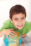 Discovering the world. Happy young boy with earth globe stock photos