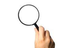 Discovery. Magnifier hand take in fingers Stock Image