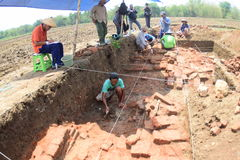 The discovery of an ancient temple. Research Team Yogyakarta Archaeological Center examined the findings of the temple in paddy fields in the hamlet Buloh Royalty Free Stock Photos