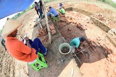 The discovery of an ancient temple. Research Team Yogyakarta Archaeological Center examined the findings of the temple in paddy fields in the hamlet Buloh Stock Image