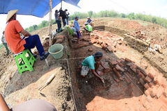 The discovery of an ancient temple. Research Team Yogyakarta Archaeological Center examined the findings of the temple in paddy fields in the hamlet Buloh Stock Photography