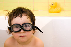 Discovery in bath. Three years old boy with water glasses in bath Royalty Free Stock Images