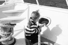 Discovery concept. Little child enjoy sea travel on ship, discovery. New discovery. Launch out on a voyage of discovery. Life is better at sea stock image
