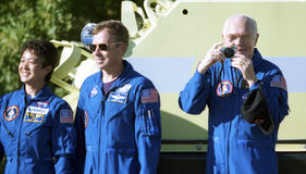 Discovery crew before the launch. Discovery crew getting ready for the upcoming launch on October 29, 1998 at Kennedy Space Center, Florida. John Glenn, right Stock Image