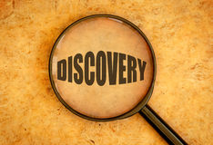 Discovery. Magnifying glass focused on the word discovery stock images