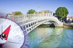 Discovery Republic of Ireland - concept image with a compass against the famous bridge in Dublin called. `Half penny bridge royalty free stock photography