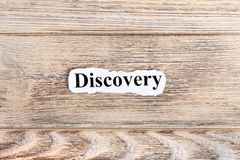 Discovery text on paper. Word Discovery on torn paper. Concept Image.  Stock Photos