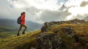Discovery Travel Destination Holiday Concept. Young Hiker Woman. Discovery Travel Destination Holiday Concept. Young Hiker Girl With Backpack Rises To The royalty free stock image