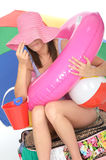 Discrete Playful Young Woman on Holiday Overloaded with Items Royalty Free Stock Images