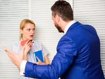 Discrimination concept. Prejudice and personal attitude to employee. Tense conversation or quarrel between colleagues. Boss discriminate female worker royalty free stock photos