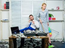 Discrimination concept. Woman cleaning up office while boss counting money. Equal rights for education work and salary royalty free stock photos