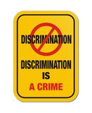 Discrimination is a crime yellow sign Stock Photo