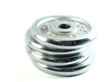 Discs. Isolated chrome plated dumbbells discs Royalty Free Stock Photo