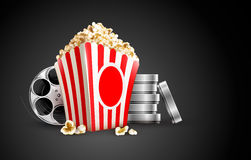 Discs with film tape reel and popcorn Stock Image