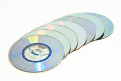 Discs in line. Stock of recordable compact discs on white Stock Image