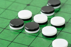 Discs on Reversi Board Stock Photos