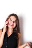 Discurso femenino caucásico joven en el teléfono Fotos de archivo