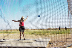 Discus 4. Women's discus competition at a college track meet Royalty Free Stock Photos