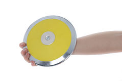 Discus in hand. Hand holding a discus on a white background Stock Image