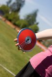 Discus in hand Stock Images