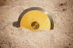 Discus throw. Disk in sand Royalty Free Stock Photography