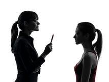 Discusión de la muchacha del adolescente de la madre de la mujer del profesor en uet de la silueta Foto de archivo libre de regalías