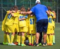 Discusión del equipo de fútbol del niño Imagen de archivo