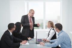 Discusión en una reunión Imagen de archivo libre de regalías