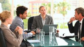 Discusion between four business people stock footage