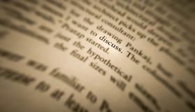 discuss word highlighted and focused in an old book stock photography
