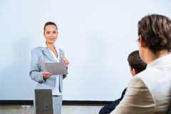 Discusses business woman with colleagues Stock Image
