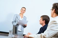 Discusses business woman with colleagues Royalty Free Stock Image
