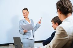 Discusses business woman with colleagues Stock Photography