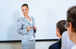 Discusses business woman with colleagues Stock Photo