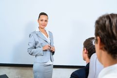 Discusses business woman with colleagues Stock Photos