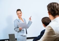 Discusses business woman with colleagues Stock Images