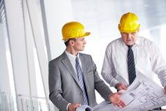 Discussing blueprint Stock Photos