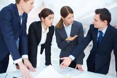 Discussing blueprint Stock Photo