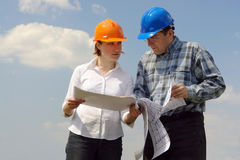 Free Discussing Building Plans Stock Photography - 5019502
