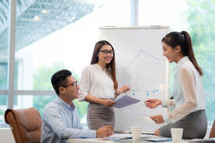 Discussing business chart Stock Images