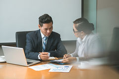 Discussing business documents Stock Images