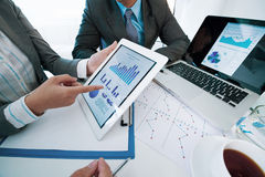 Discussing business graphs Stock Images