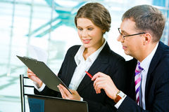 Discussing business plan Stock Image