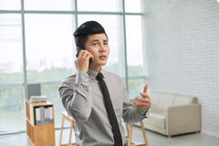 Discussing business project on smartphone Stock Photo