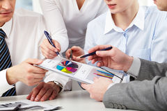 Discussing charts Stock Images