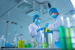 Discussing chemical liquids Royalty Free Stock Image