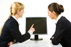 Discussing computer work Stock Images