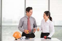 Discussing construction layout Royalty Free Stock Photos
