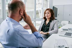 Discussing cooperation with business partner Stock Photography