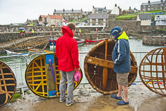 Discussing coracles at Portsoy Royalty Free Stock Image
